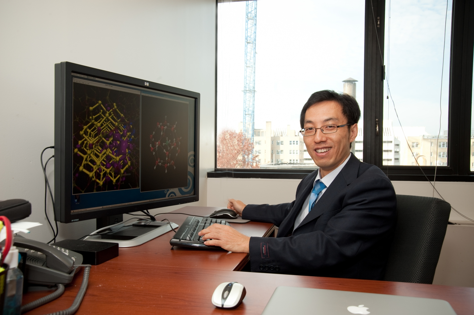 Dr. Tianshu Li at his desk