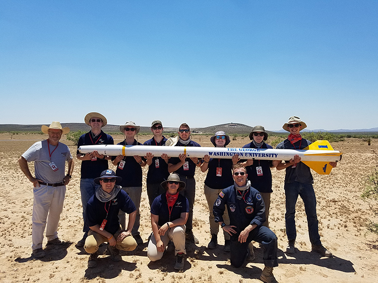 Rocket team with their rocket in the desert