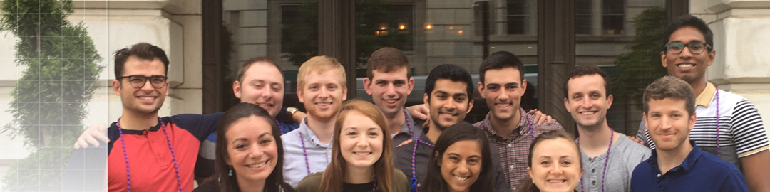 Photo of undergraduate students in front of a building