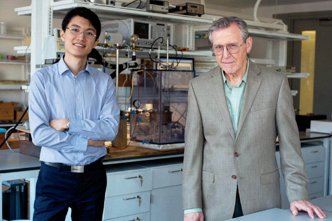 Professor Roger Lang and his graduate student in a lab