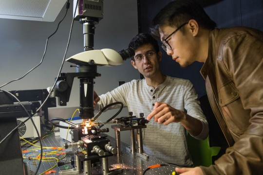 Photo of a professor and student in a scientific lab in the science and engineering hall.